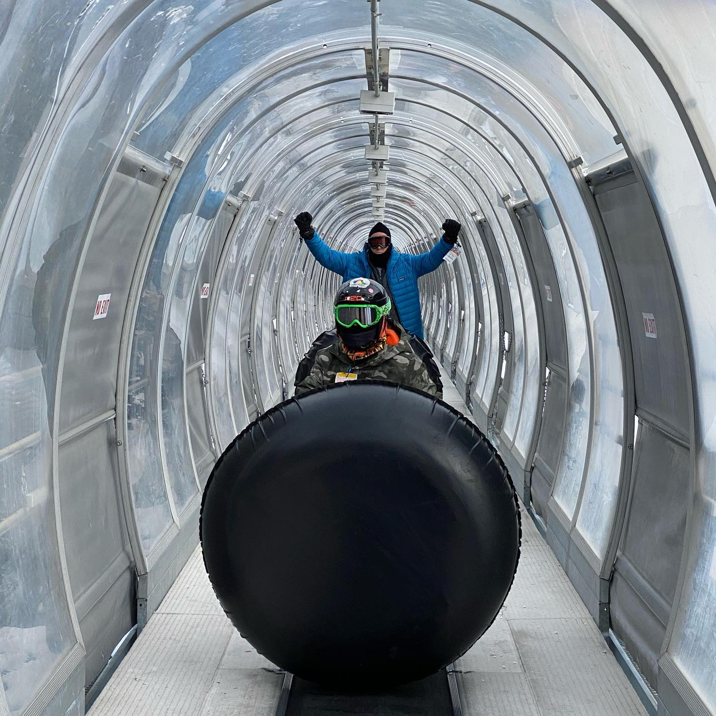 Tubing at Keystone Colorado- you get to ride up the mountain on this magic carpet ride in an enclosed tunnel.  So no work to get back up the hill and great fun sliding down on tubes.  This was a great family activity and you get to ride up the mountain in the gondola. #keystonetubing #tubingfun #tubingincolorado #winteractivitiesforkids