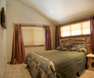 Bedroom 4 has a king sized aspen lodgepole bed